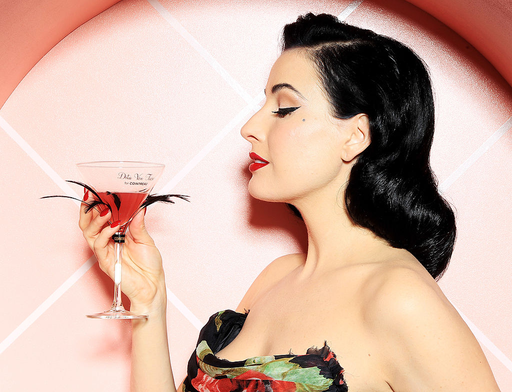 A woman holds her martini glass