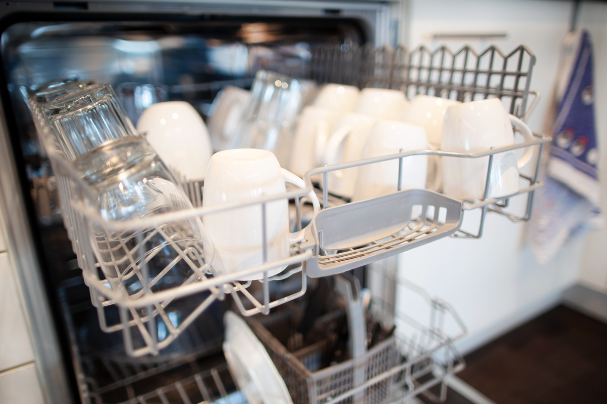 Glasses and cups stand in a dishwasher in Düsseldorf.