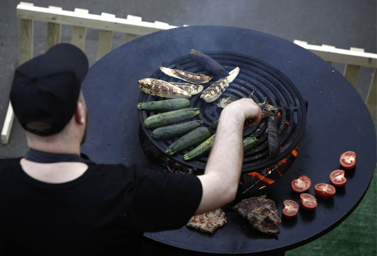 Grilling vegetables and meat during the 2019 Russian Grill Fest