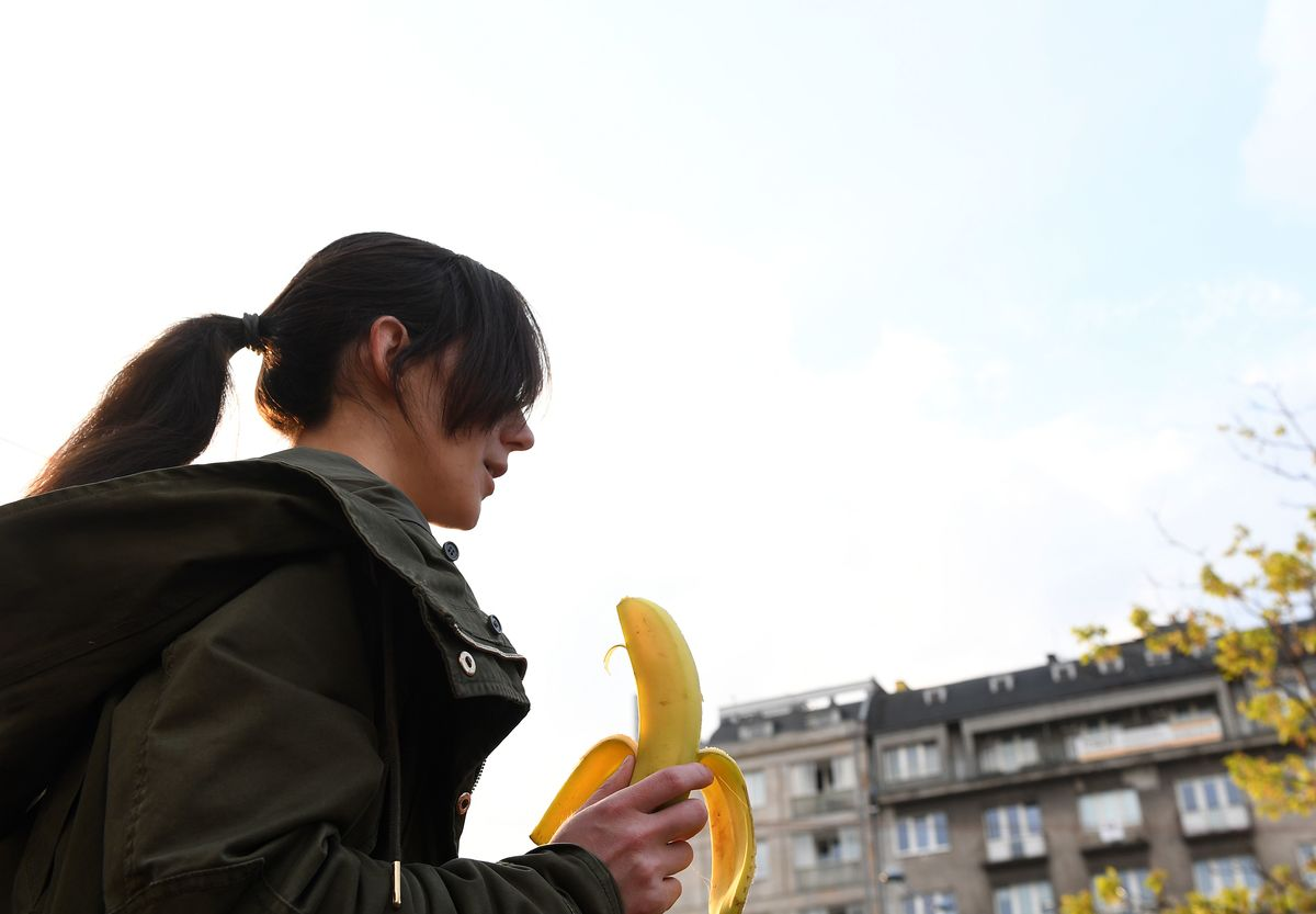 A woman with a banana demonstrates outside Warsaw's National Museum to protest against censorship
