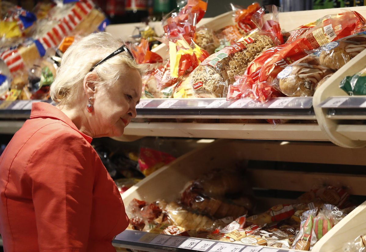 A customer choosing bread at a Pyaterochka supermarket