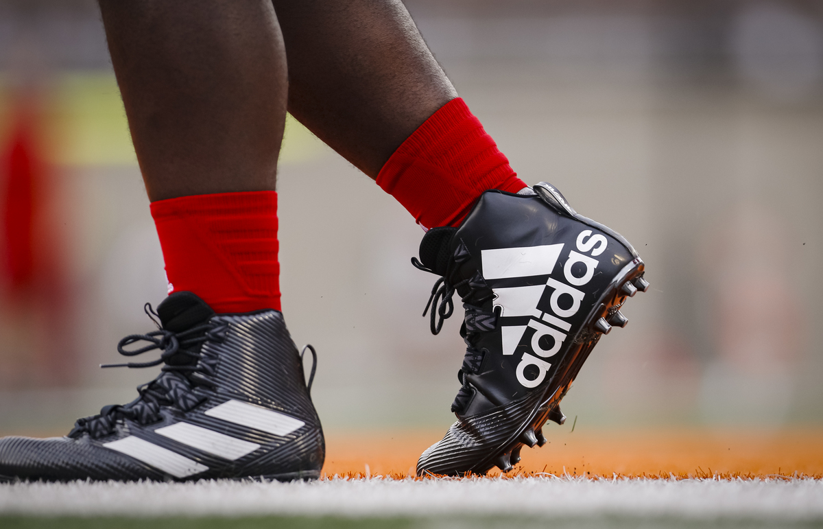 Nebraska Cornhuskers players in Adidas shoes are seen before the game against the Illinois Fighting Illini