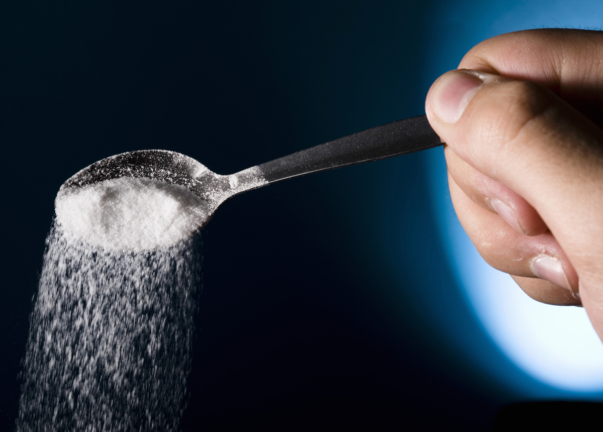 Salt spilling out from spoon