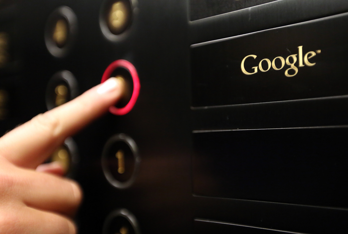 A visitor pushes a button in the Google offices' elevator