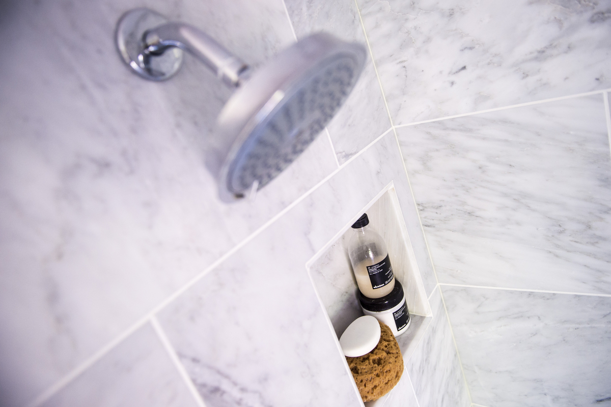 A shower is seen as Sara Goo shows off her recently renovated bathroom in her home