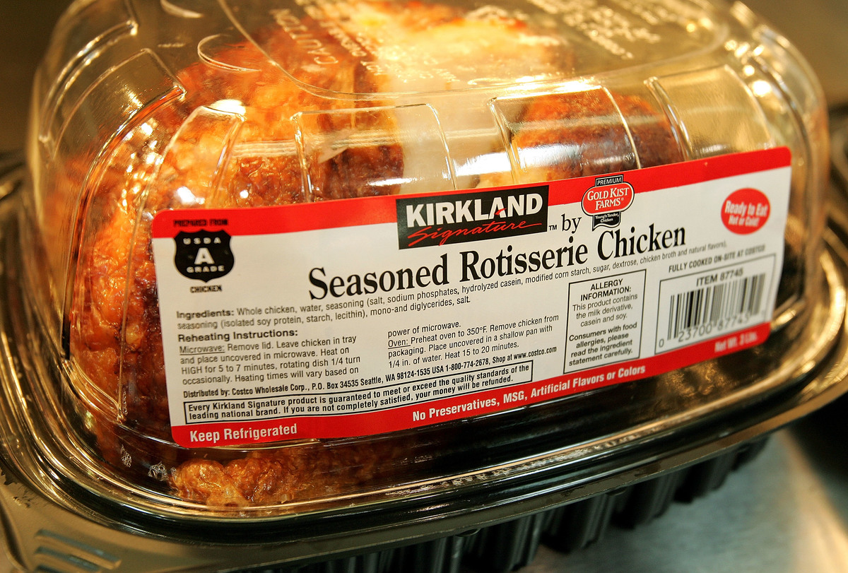Signature premium brand roasted rotisserie chicken sits at a Costco store