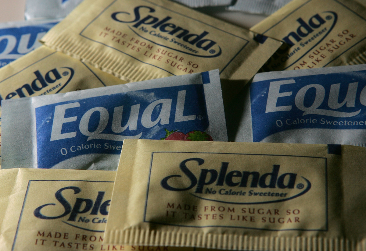 Packages of Equal and Splenda artificial sweeteners are displayed at a coffee shop