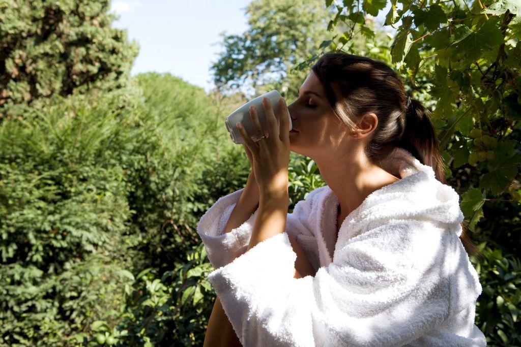 Woman Drinking In Terrace.
