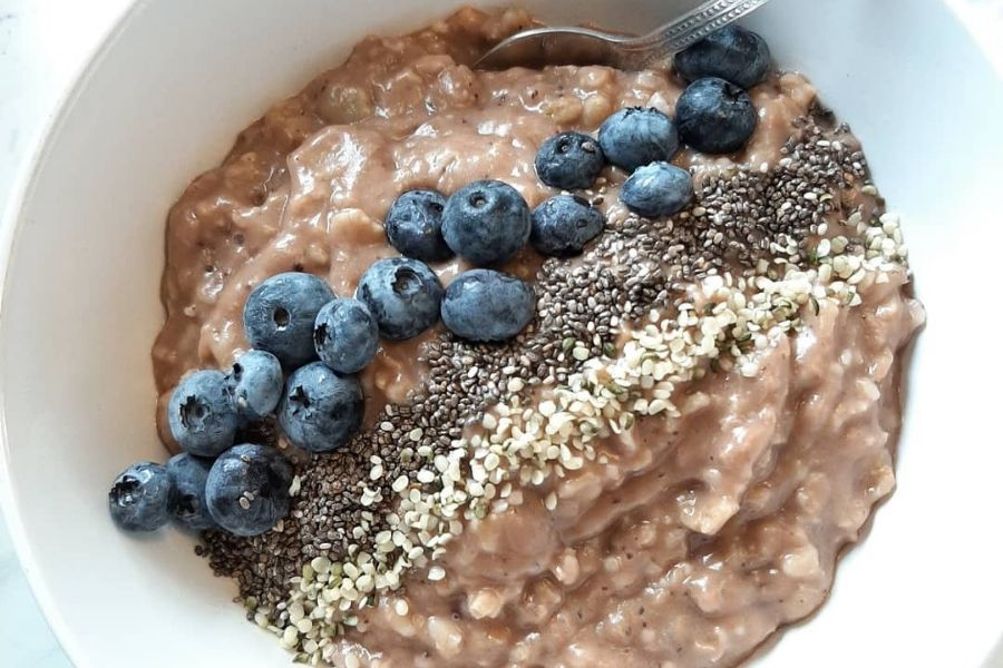 Peanut butter oatmeal with chia seeds and blueberries
