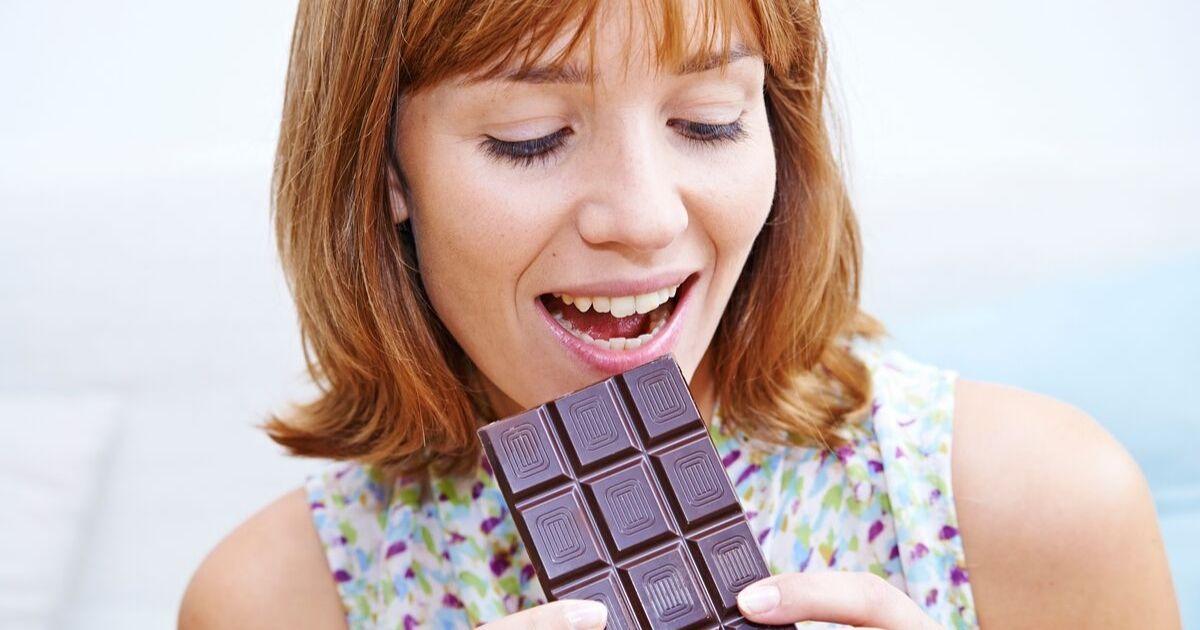 Woman eating chocolate.