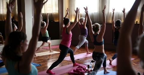 A group of women participate in a lululemon yoga class