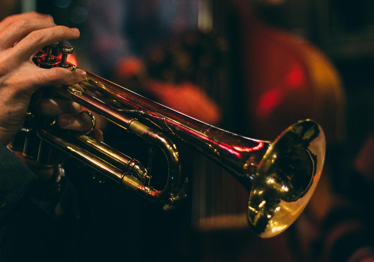 Musician plays a brass trumpet