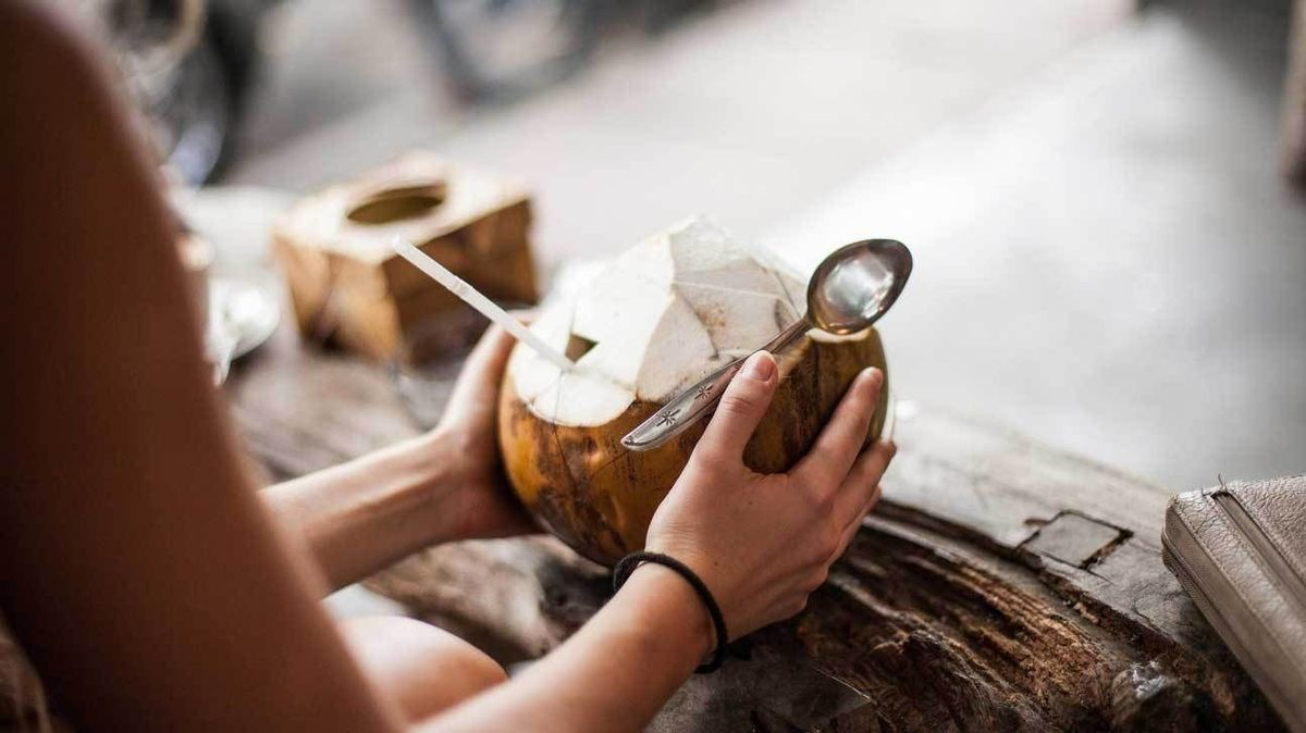 drinking water from a coconut