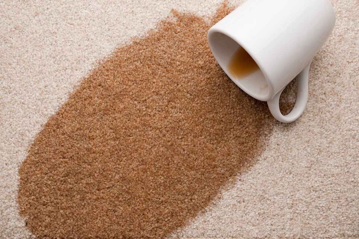 Coffee spills onto white carpet