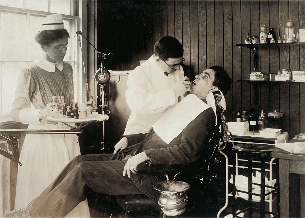 Photograph of a patient in a dentist's chair having dental work