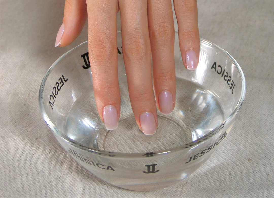 Soaking nails in warm water
