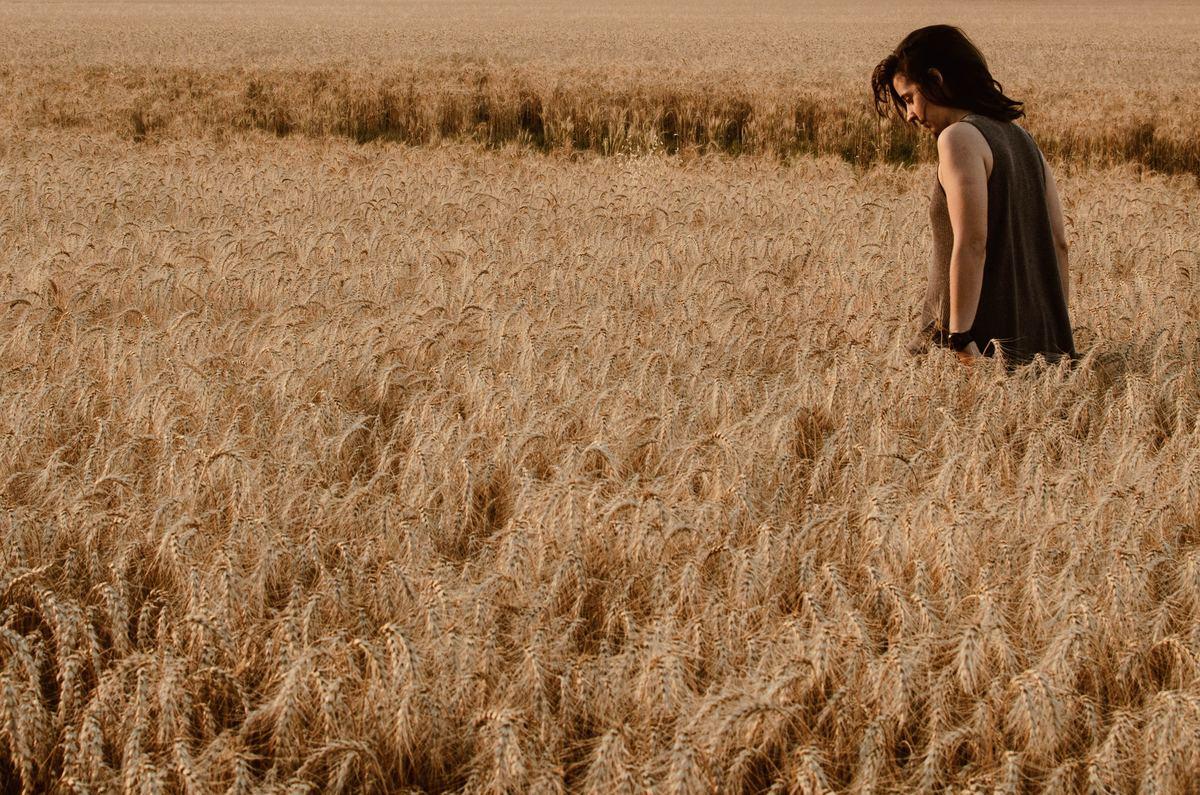 Woman walks through a wheat field in Argentina