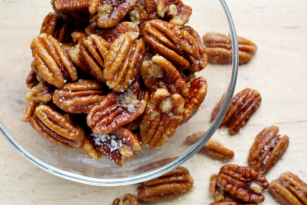 a close-up of a bowl of pecans