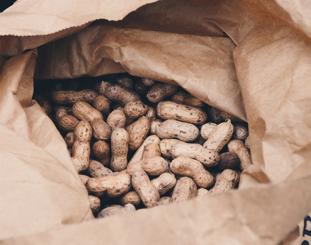 Opened paper bag of peanuts from Dăbuleni, Romania