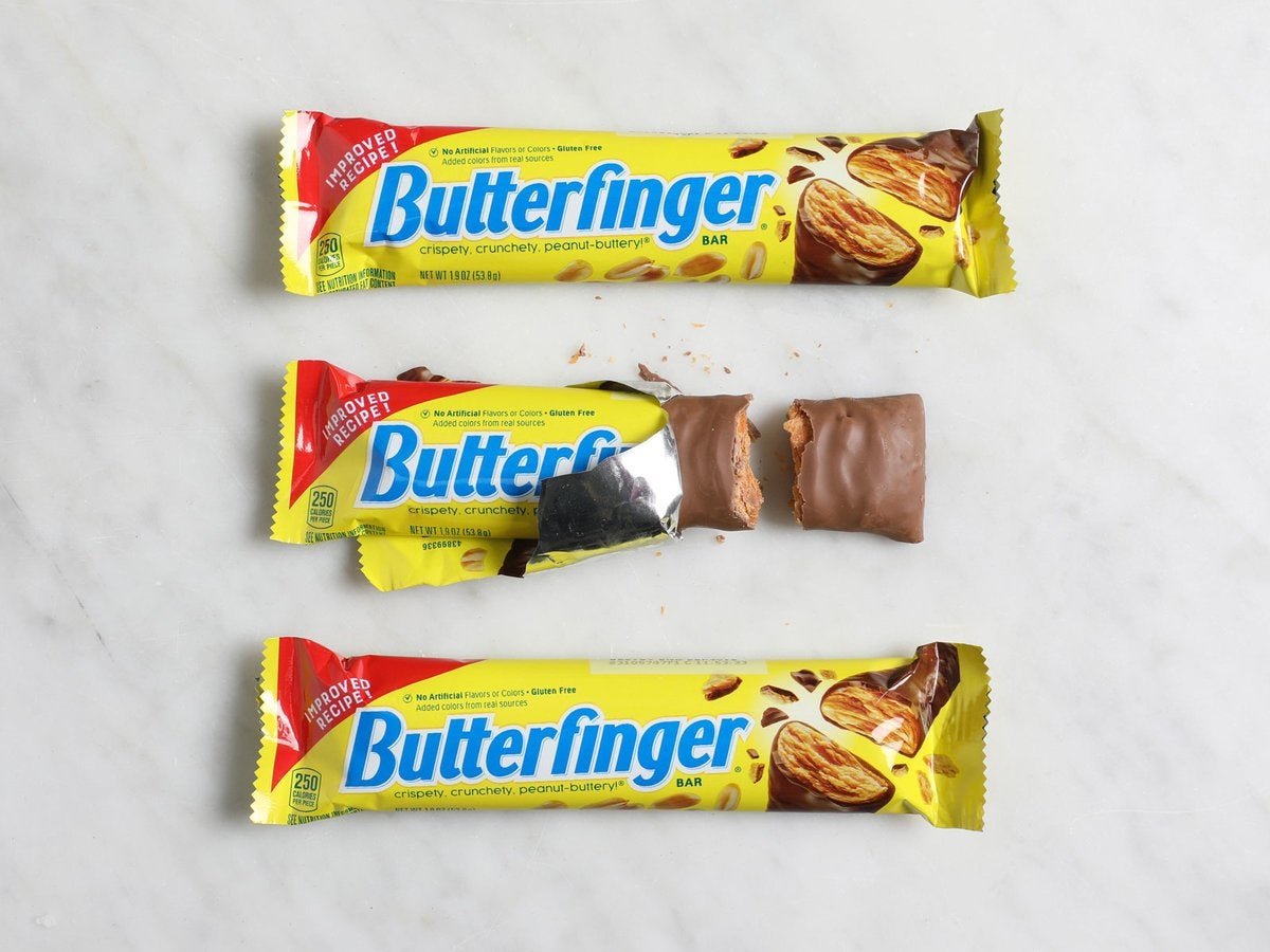 Three Butterfingers bars sit on a table.