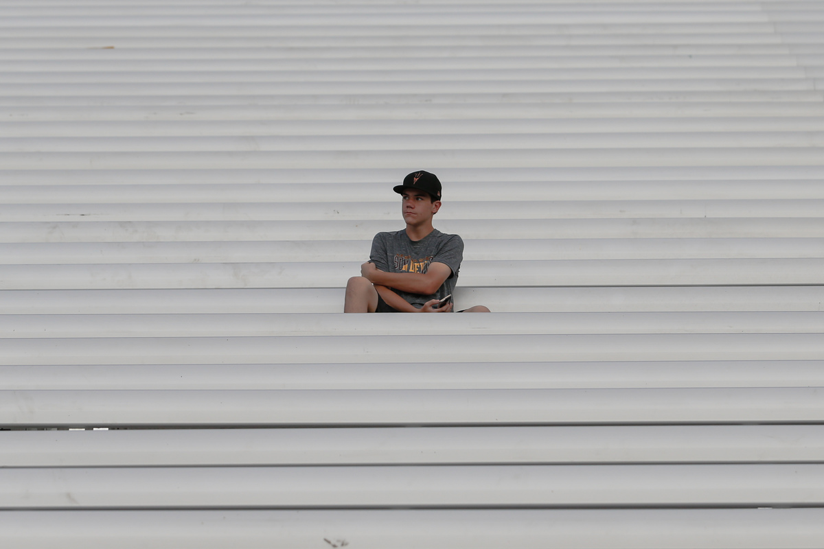 A single fan sits in the stands before the college football game between the UTSA Roadrunners and the Arizona State Sun Devils