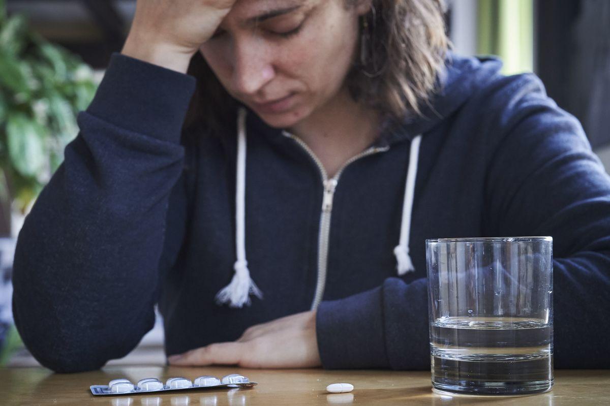 Someone with a headache takes Ibuprofen