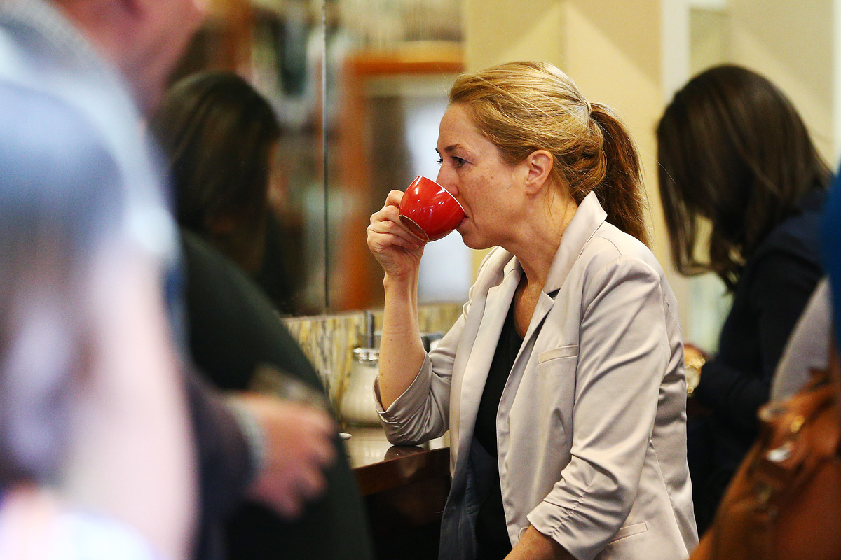 People drink coffee inside Pellegrini's Espresso Bar