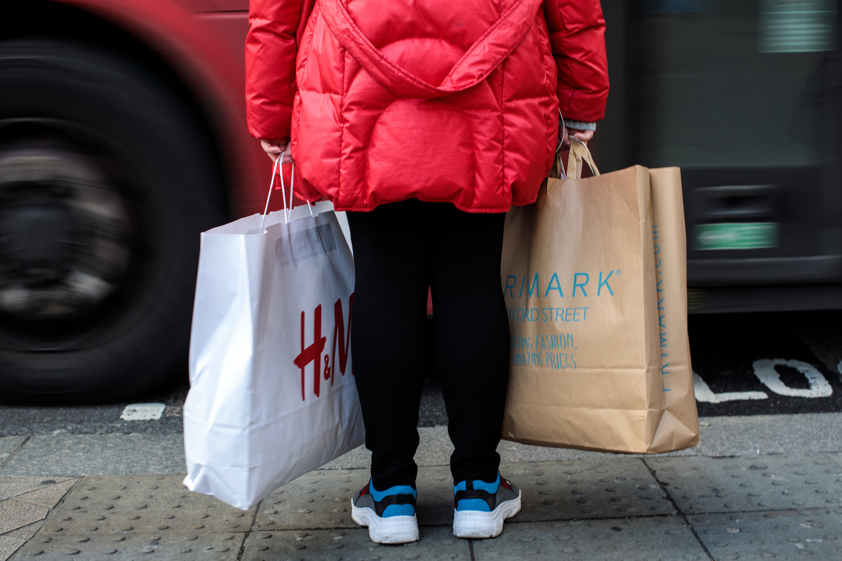 Shoppers carry their bags along Oxford Street
