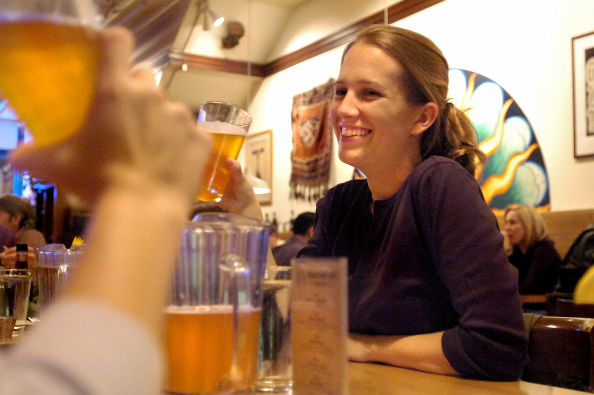 Katie Courvoisier talks with friends while partaking in the late night happy hour