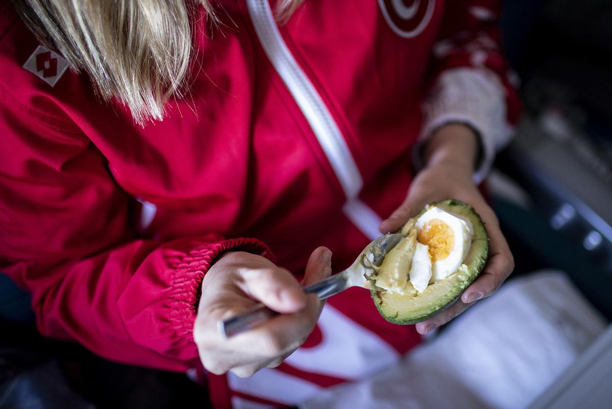 An internationally renowned Turkish diver, Sahika Ercumen eats avocado and egg during a flight to Sao Paulo