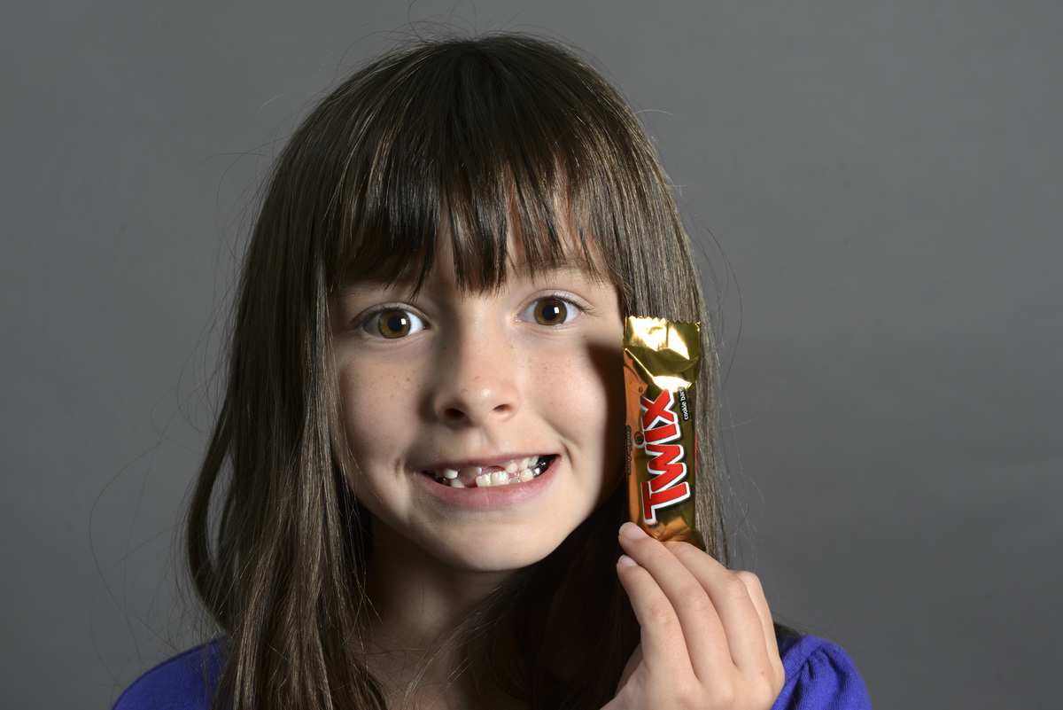 Ryleigh Bunn, 7, holds up a Twix bar.