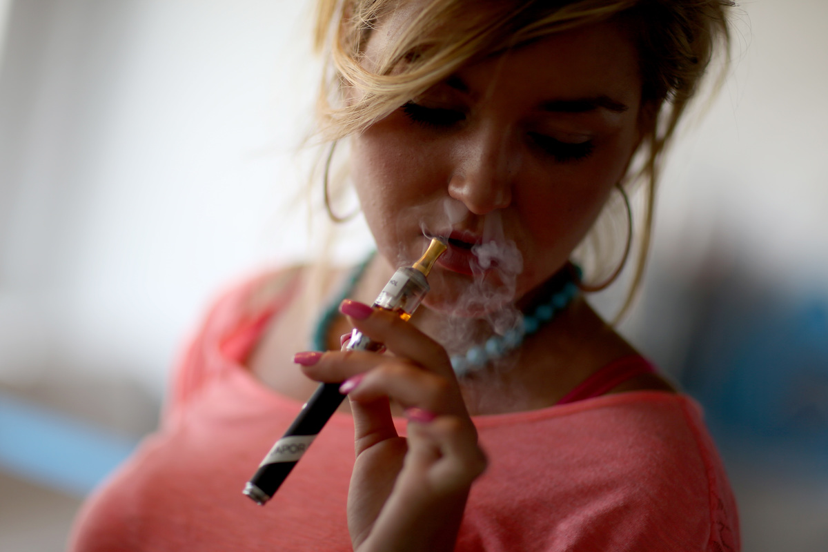 Chloe Lamb enjoys an electronic cigarette at the Vapor Shark store