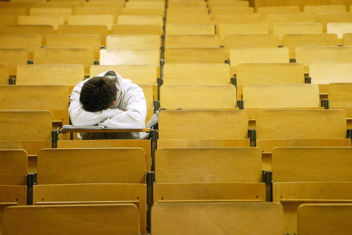 A student naps in a lecture hall at the Freie Universitaet