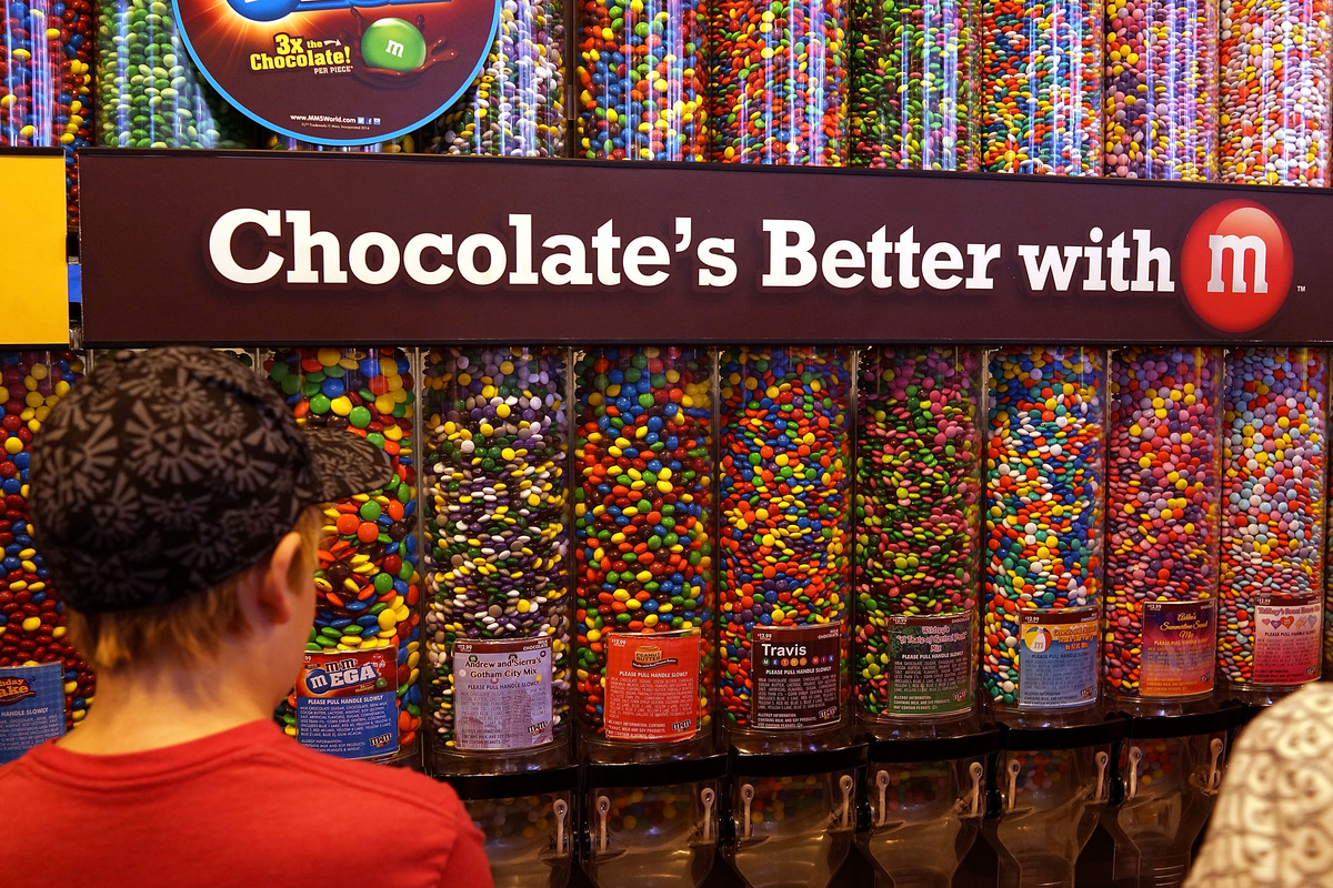 Boy stares at the towers of M&M's in the M&M store in Times Square