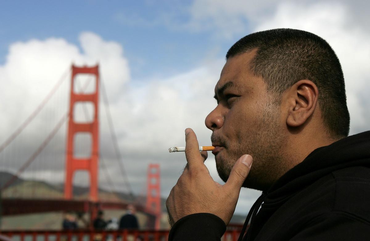 Henry James smokes a cigarette near the Golden Gate Bridge
