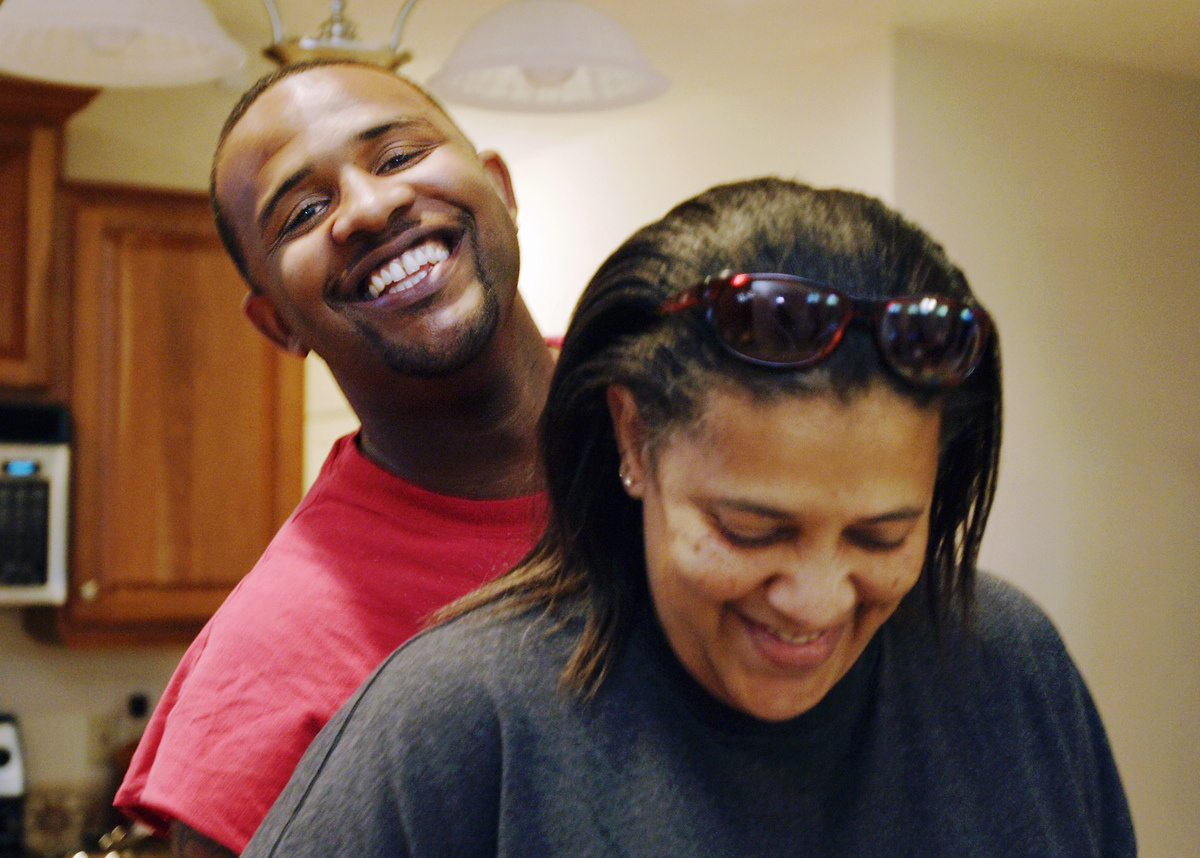 Sabathia Jr. #52 of the Cleveland Indians hugs his mom as she serves up dinner at home