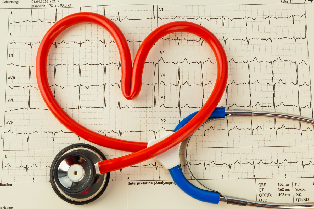 symbolic photo heart attack, heart disease, heart-shaped stethoscope on a med.