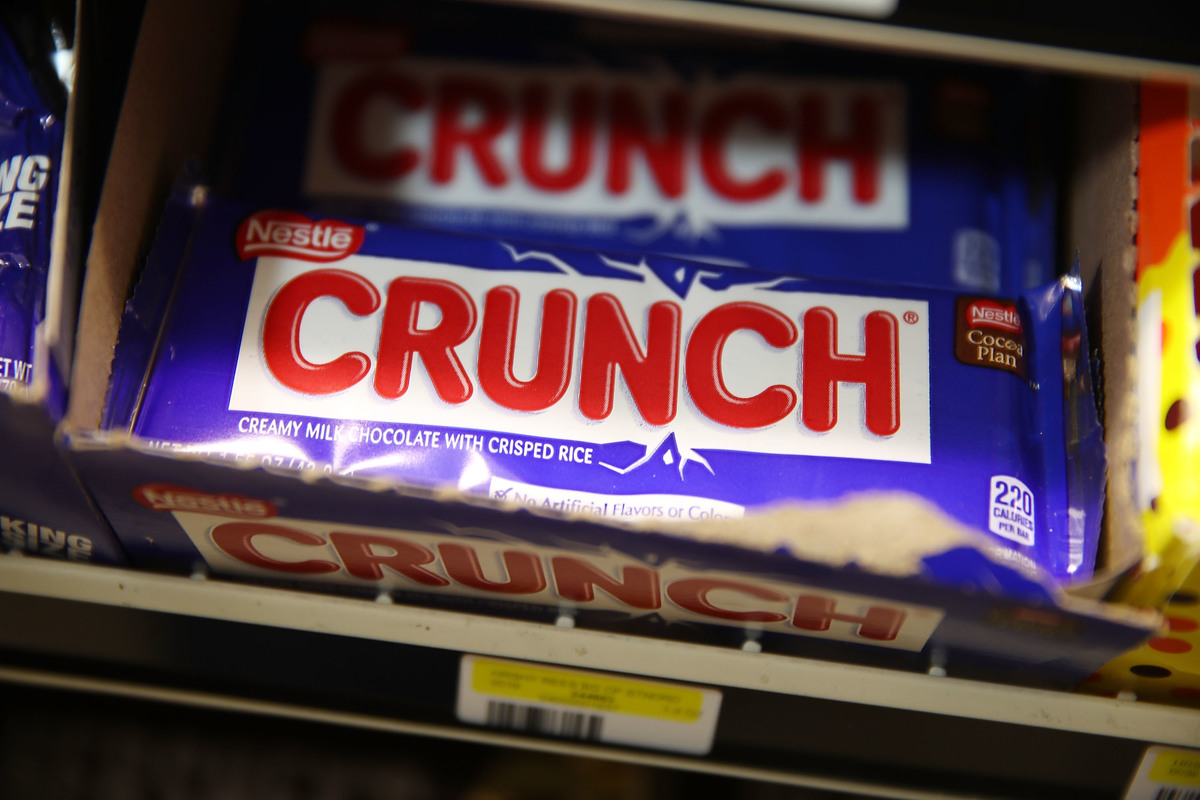 Nestle Crunch bars are seen on a store shelf
