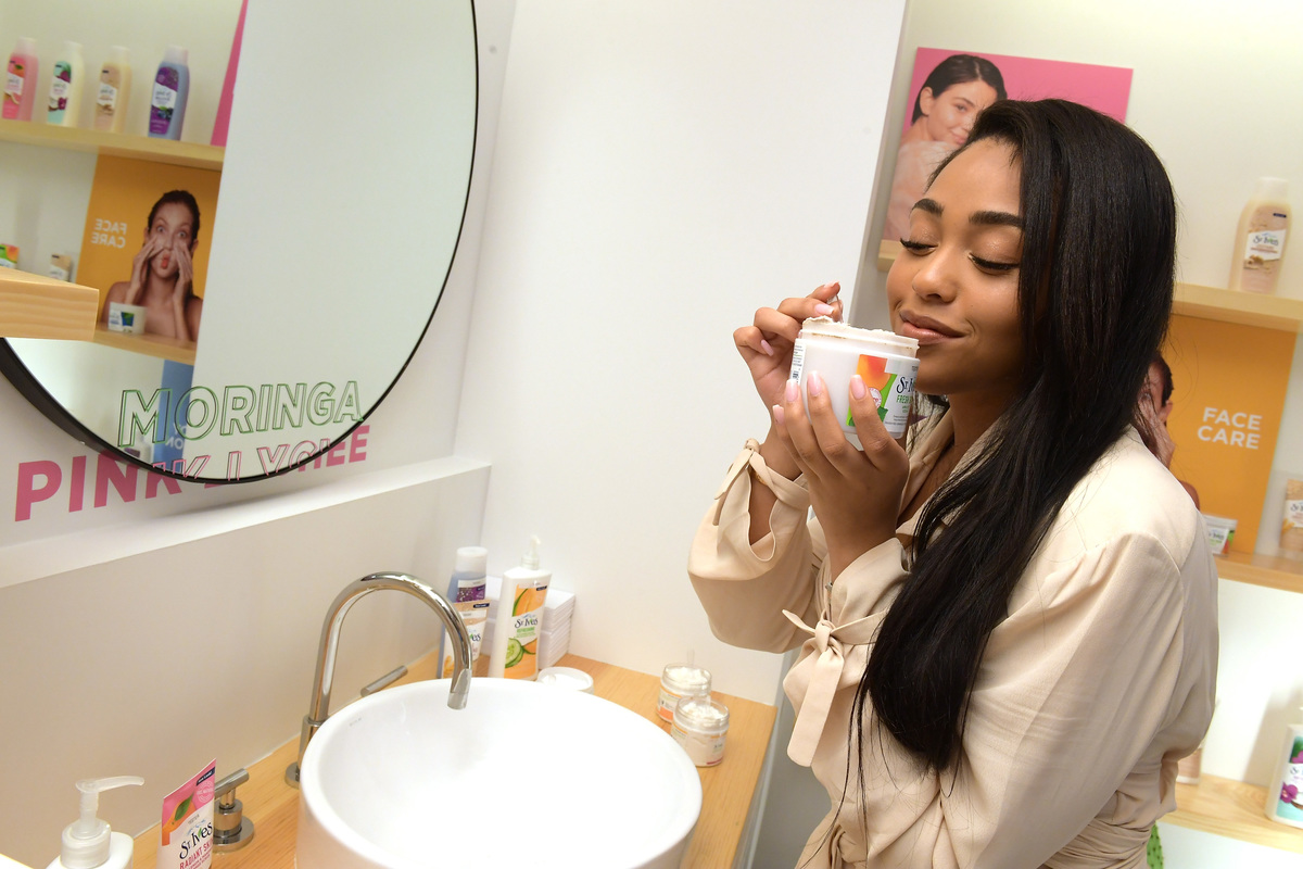 Jordyn Woods at the St. Ives Mixing Bar in Flatiron creates custom scrubs and lotions