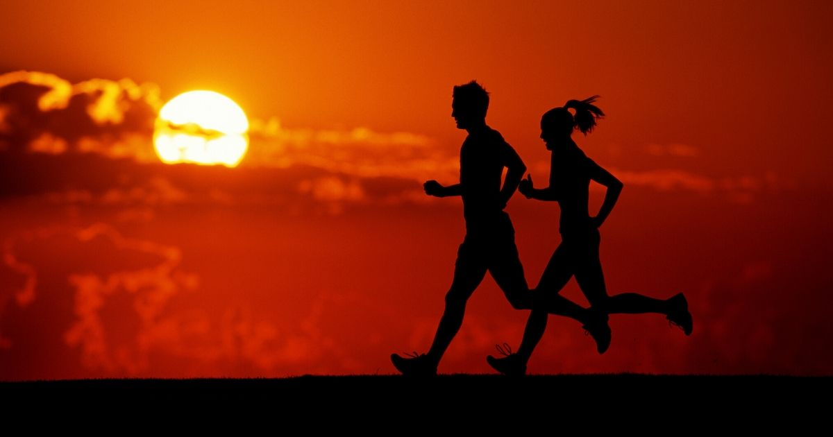 Runners silhouette at sunset