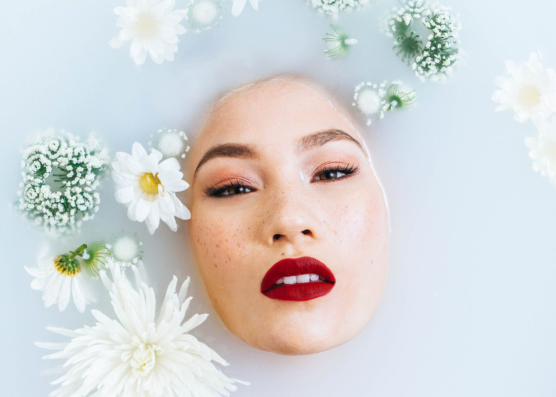 Beautiful Face In A Milk And Flower Bath from Pixabay