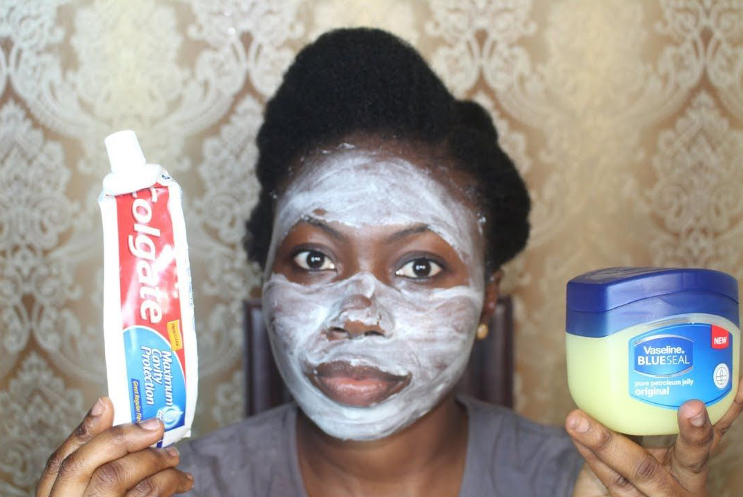 YouTuber applies Colgate toothpaste and vaseline to her face.