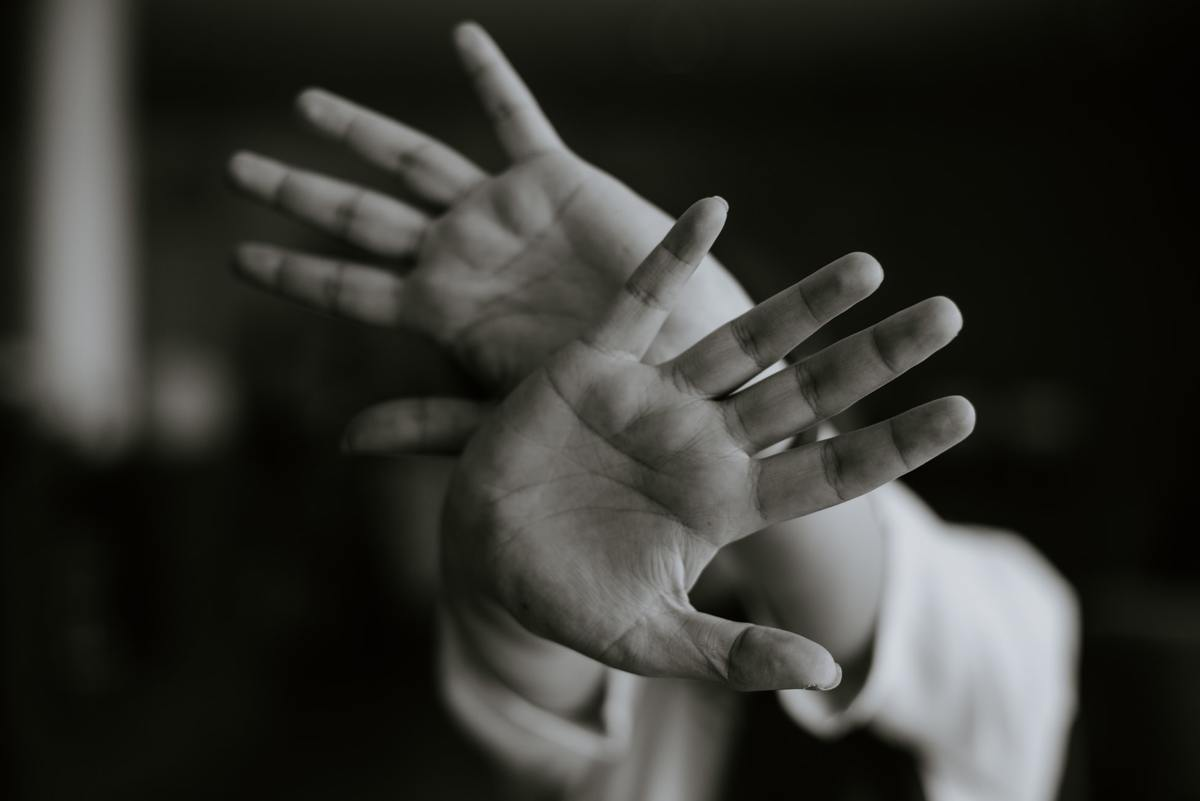Hands signal someone to stay away