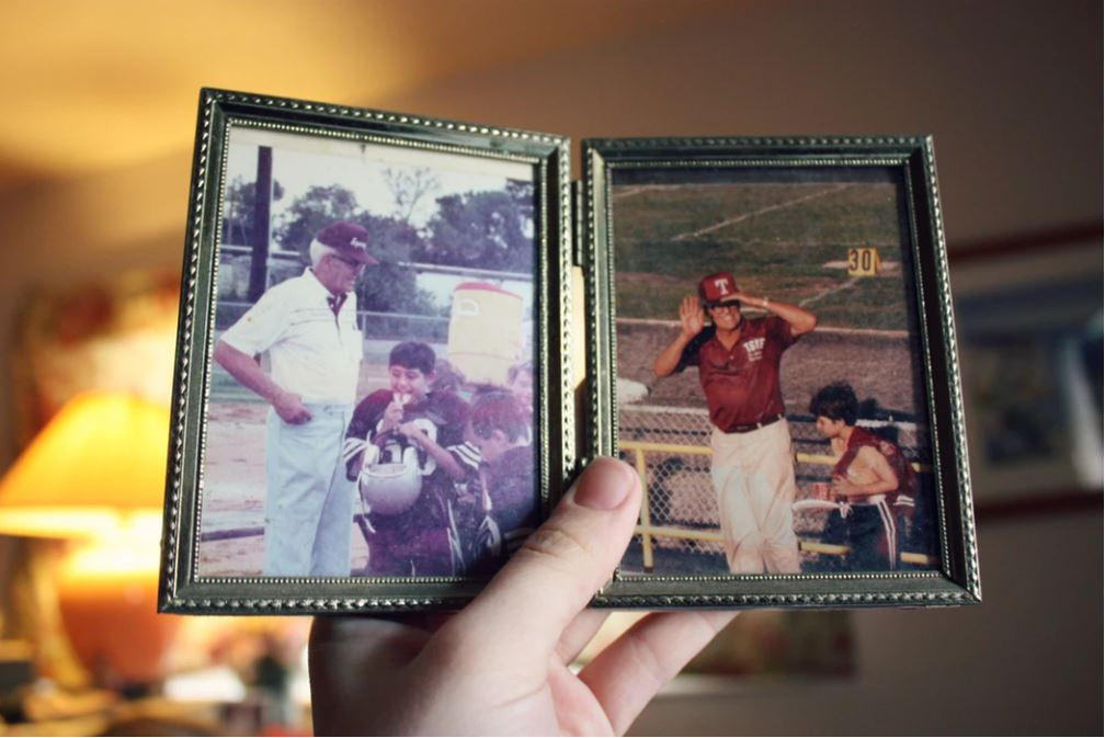 Person holds an old photo album