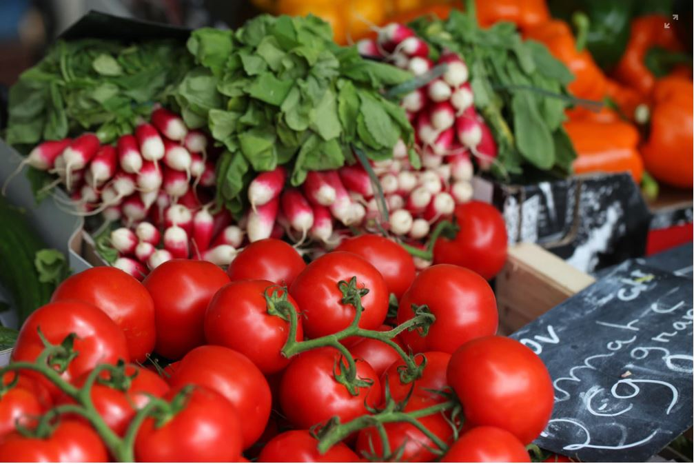 Tomatoes and radishes on sale at a farmer's market