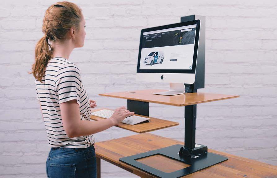 Woman uses a standing desk