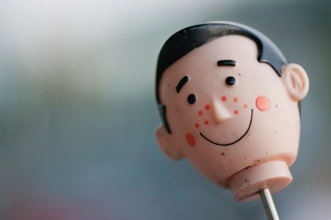 Vintage toy head with acne