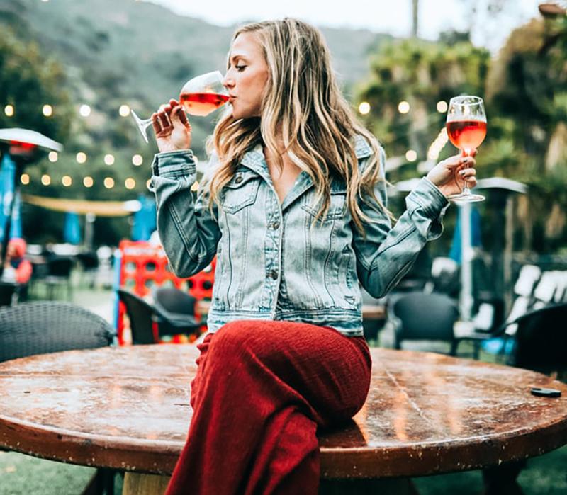 Woman drinks wine in Malibu, California