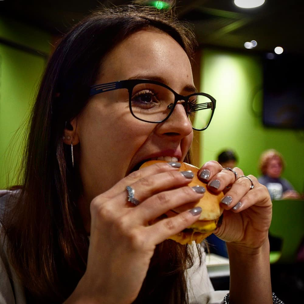 taking a bite of a hamburger
