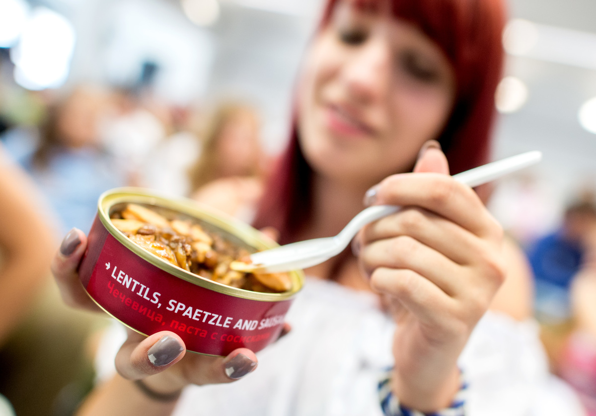 The student Joane tries canned lentils and spaetzle with sausage.